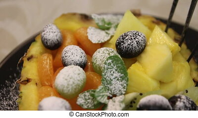 fruits on pineapple - assorted fruit . grapes on pineapple