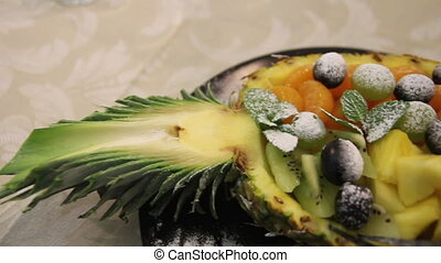assorted fruit on pineapple - assorted fruit . grapes on...