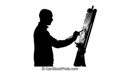 Talanted, bearded, bald painter drawing a painting by oil...