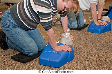 Woman Taking CPR Class - This women are taking a CPR safety...