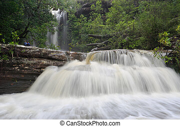Splendour of a Waterfall - Tourists gaze at the splendour of...