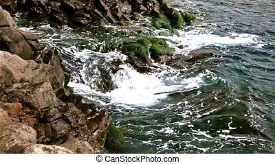 Wild stone and rock ocean shore - Waves on wild rock and...
