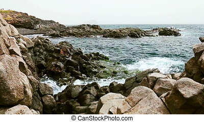 Wild stone and rock ocean shore - Rock and waves on shore or...
