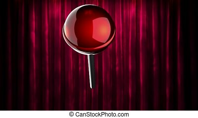 loop rotate red lollipop at curtain