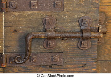 rusty lock with deadbolt to close the door of the medieval...