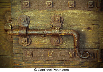 old lock with big deadbolt to close the door of the castle -...