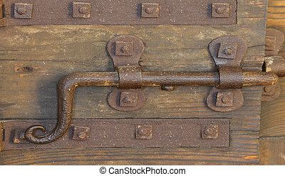 old rusty lock with deadbolt to close the door of the castle...