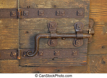 rusty lock with big deadbolt to close the door of the...
