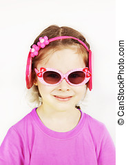 Smiling little cute girl wearing pink sunglasses