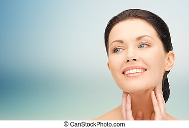 beautiful young woman touching her face and neck - beauty,...