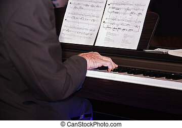 piano player - old caucasian man playing the piano, musical...