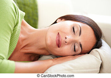 Attractive young woman resting with eyes closed