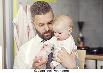 Father and daughter - Young father with his cute little baby...