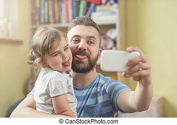 Father and daughter - Young father with his cute little...