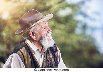 Farmer outside in nature - Senior farmer outside in...