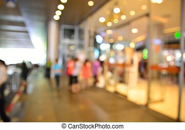 Blur or Defocus image of People enter entrance door of...
