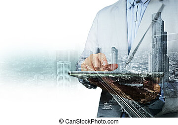 Double exposure of city and businessman on the phone as...