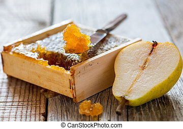 Honey comb and a slice of pear.