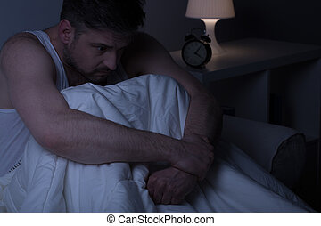 Man sitting in the bed