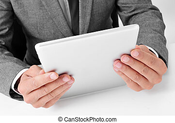 businessman using a tablet computer - closeup of a young...