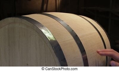 Hand irons oak wine barrels in the workshop. - Hand irons...