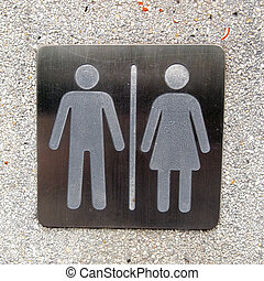 toilet plate sign on wall