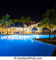 View of hotel and swimming pool at night