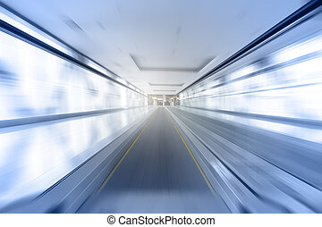 Travelator in motion - abstract business and architectural...