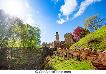 View of Lowenburg castle on the hill and stairs up at early...