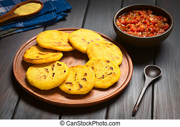 Colombian Arepa with Hogao Sauce - Wooden plate of arepas...