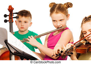 Group of cute kids playing on musical instruments