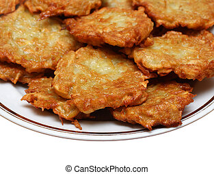 potato pancakes on plate - heap of potato pancakes on plate