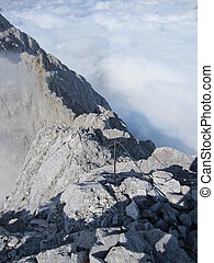 Watzmann via ferrata climbing route above the clouds