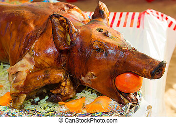 Decorated and roast suckling pig on a table on banquet....