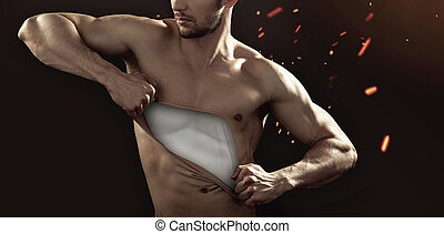 Muscular man pulling his chest skin away
