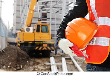 Construction safety concept, close-up worker wearing safety...