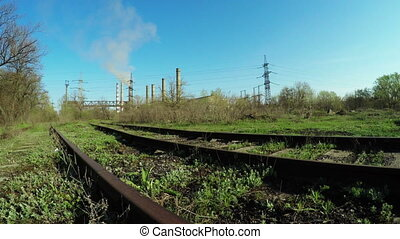Railway near thermal power plant - Camera on steadicam over...