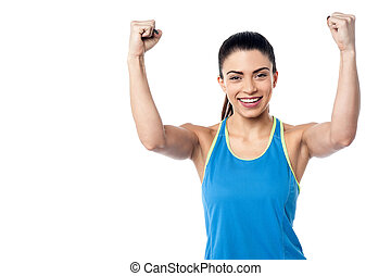 Strong young fit woman - Fit woman showing her biceps