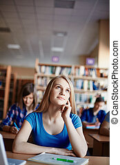 Daydreaming - Cute girl daydreaming at lesson in college