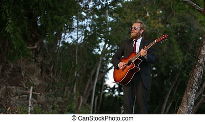 bearded guitarist plays and goes out - bearded guitarist in...