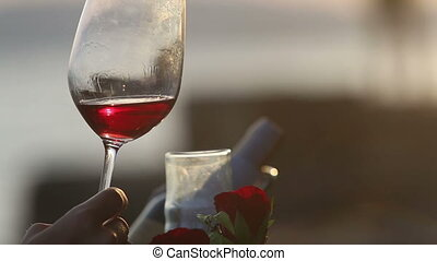 woman and man hesitate then touch glasses of wine - woman...