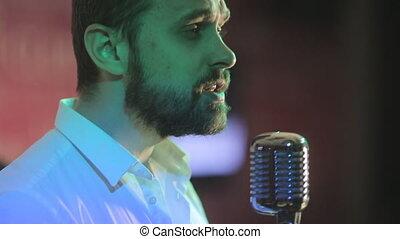 Brutal man performs the song in karaoke club in retro...