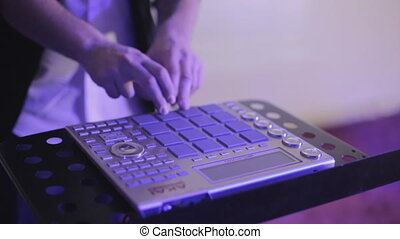 Close-up of the controller playing music in the club -...