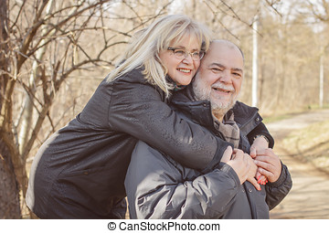 Happy Senior Man Mature Woman Piggyback Outdoor - Happy...