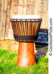 Original african djembe drum with leather lamina, on green...