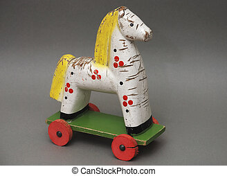 wooden horse - old toy wooden  horse with red wheels