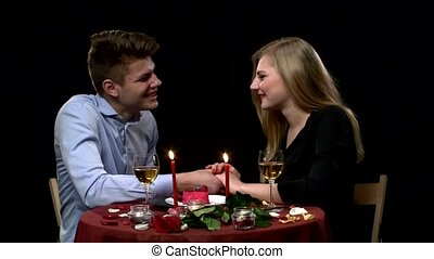 Portrait of beautiful couple enjoying each other's company in a romantic dinner. Close up