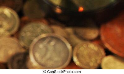 examining an old coin - close-up view examining an half of...