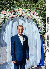 wonderful stylish rich happy groom at wedding ceremony in...