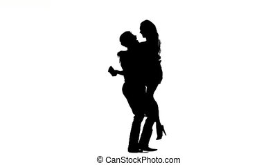 couple man and woman walking hand in hand. Silhouette